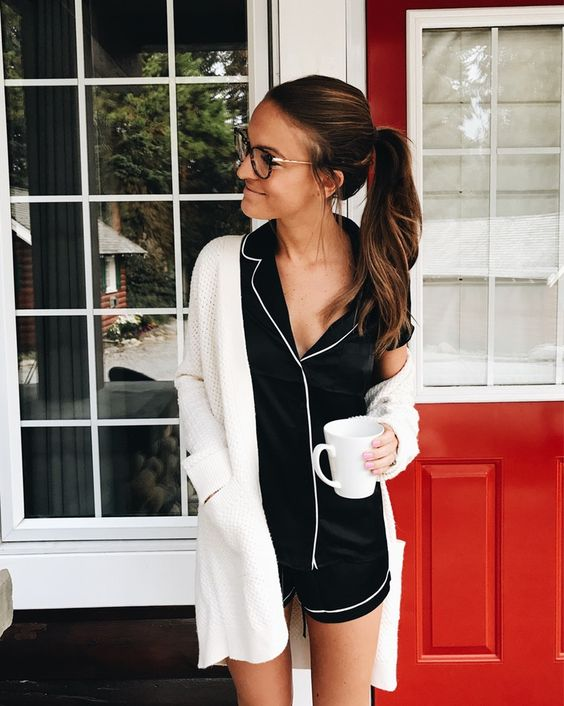 black silk pajamas with white edging and a white cardigan over it for a classic and timeless look