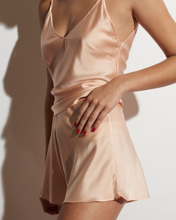 cool peachy pink silk pajamas with a spaghetti strap top and wide shorts are perfect for home
