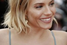 11 short wavy hair with two mini twisted braids on top are an easy and cute hairstyle to rock