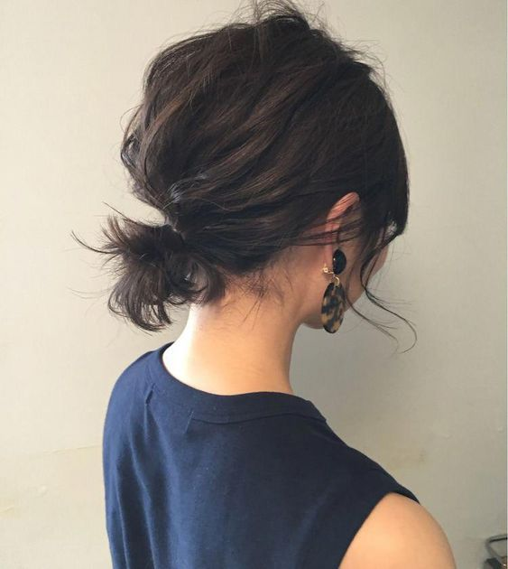 a simple super messy low ponytail with a messy bump and some locks down always works