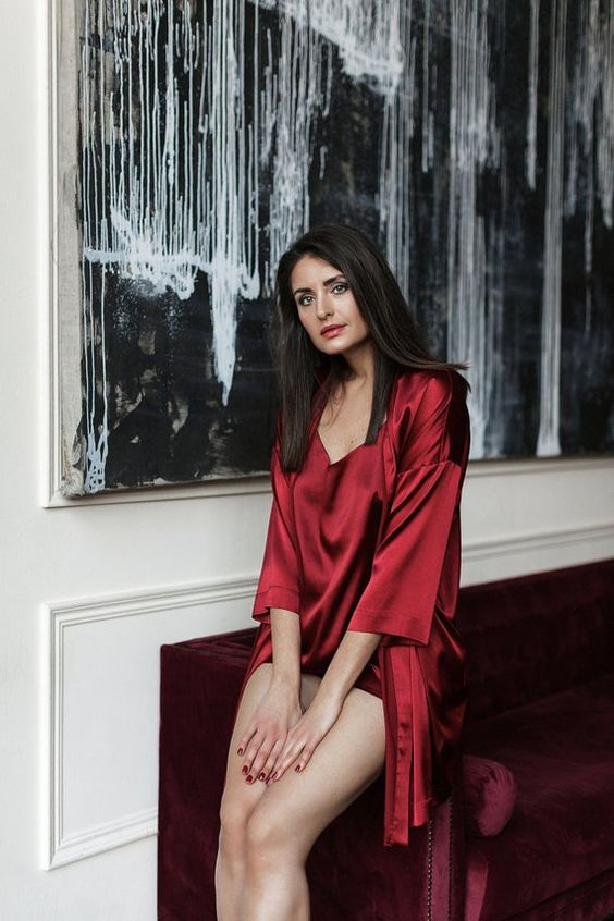 a red silk mini gown and a matching robe with short sleeves are a cool and bright set to wear at home