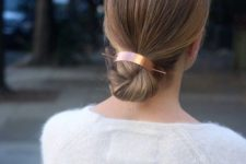 13 a sleek low bun with a sleek top secured with a copper hair cuff is a stylish and minimal idea