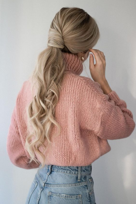 a twisted low ponytail with waves and a voluminous top for a romantic and stylish look