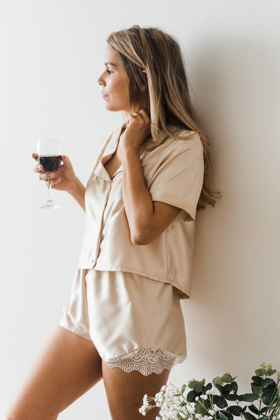 neutral silk pajamas with an oversized top and shorts with lace inserts are chic and very comfy