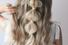16 an easy half updo with a bubble braid and waves is a romantic and boho option to go for