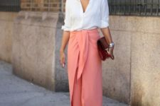 With V-neck blouse, marsala clutch and beige pumps