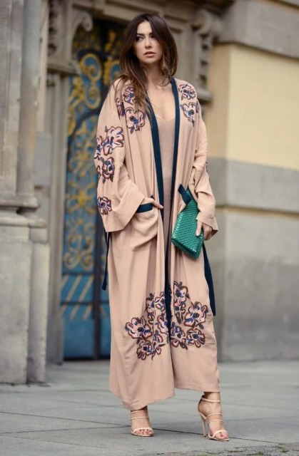 With beige dress, beige high heels and green clutch