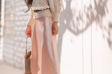 With beige sweater, wide brim hat, belt, bag and pale pink midi skirt