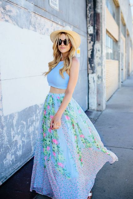 With beige wide brim hat and floral maxi skirt