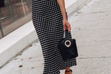 With black ankle strap high heels and black leather bag