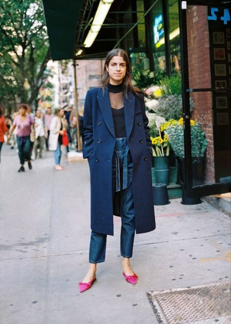 With black blouse, belted jeans and navy blue midi coat