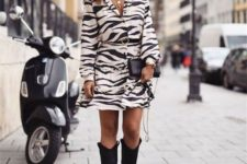 With black clutch and black high boots