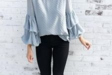 With black distressed pants and black flat mules