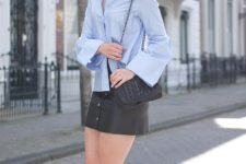 With black leather mini skirt, bag and flat shoes