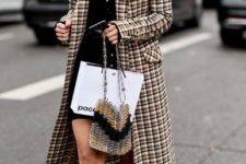 With black mini dress, checked coat and unique bag
