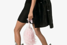 With black mini dress, pale pink bag and leather jacket