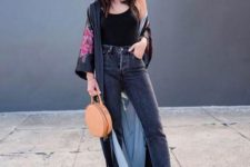 With black top, cropped jeans, round bag and black pumps