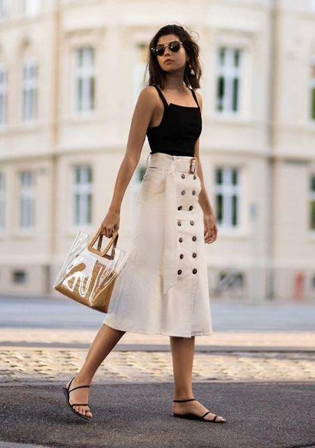 With black top, transparent bag and black flat sandals