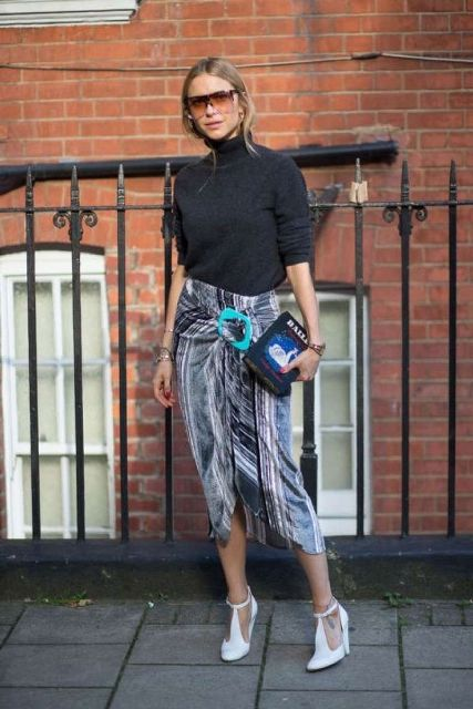 With black turtleneck and printed wrapped skirt