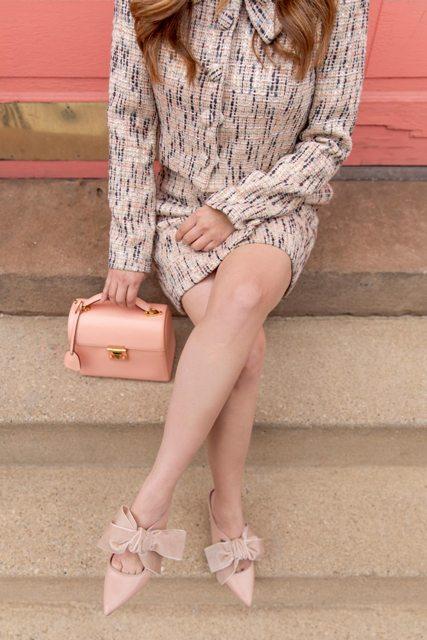 With blazer, skirt and mini bag