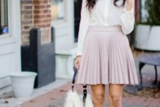 With blouse, faux fur bag and beige pumps