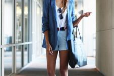 With blue long blazer, black tote bag, white top and white sneakers