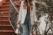 With brown satin top, cropped jeans, white bag and striped shoes