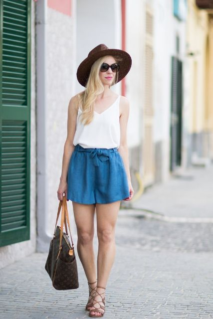 With brown wide brim hat, white loose top, printed bag and lace up shoes