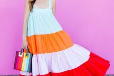 With colorful bag, beige tassel shoes and sunglasses