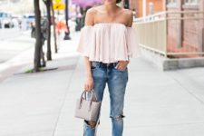 With cuffed jeans, gray bag and fringe shoes