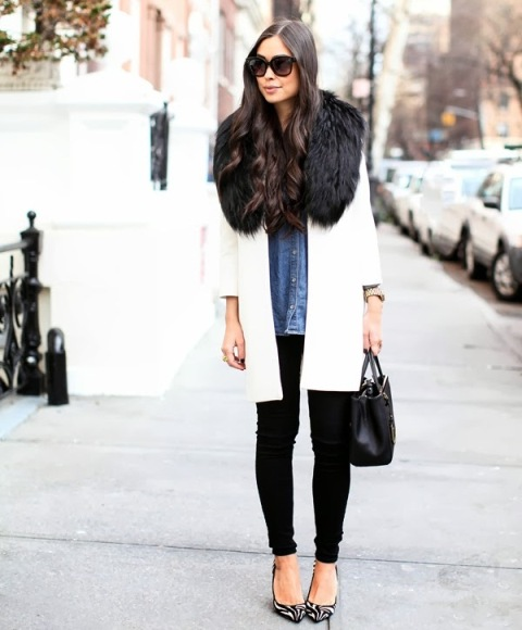 With denim button down shirt, white coat, black pants and black leather bag
