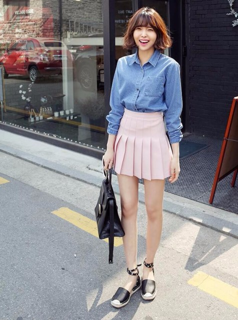 With denim shirt, black leather bag and black flat shoes