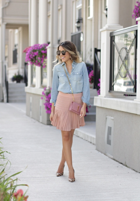 With denim shirt, pale pink bag and leopard pumps