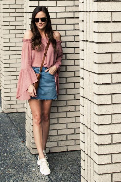 With denim skirt, brown bag and white sneakers