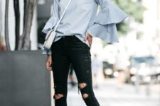 With distressed pants, white crossbody bag and black high heels