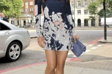 With floral mini dress and pale blue clutch