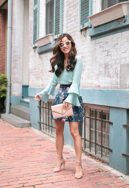 With floral mini skirt, pale pink clutch and beige high heels