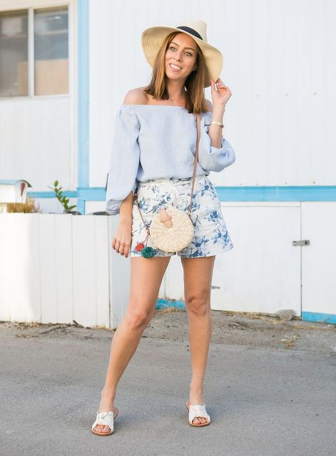 With floral shorts, hat, crossbody rounded bag and white flat sandals