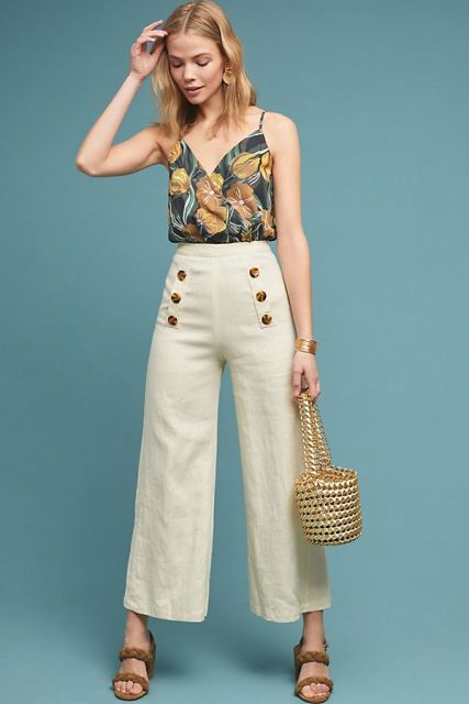 With floral top, golden bag and brown shoes
