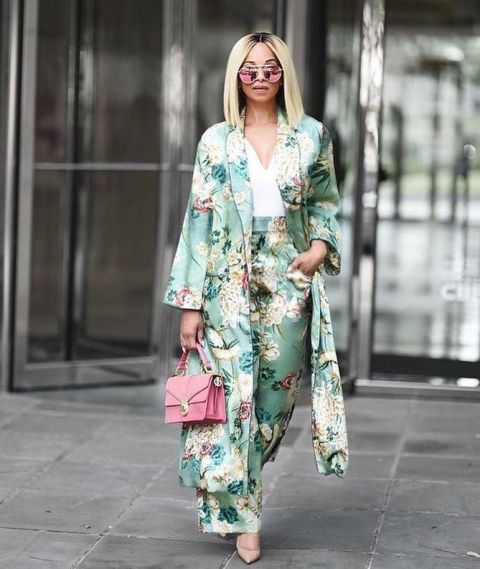 With floral trousers, white blouse, pink bag and beige pumps
