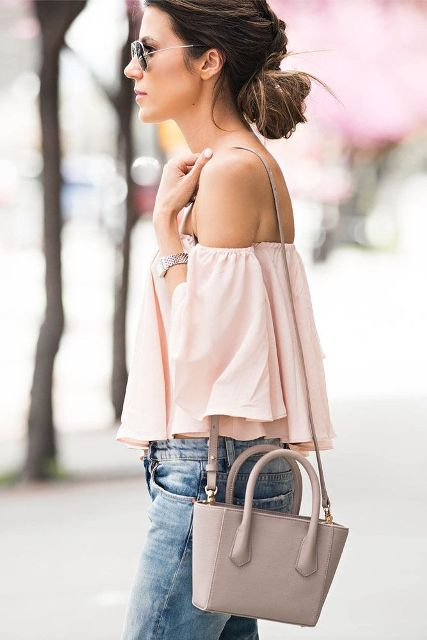 With gray bag and jeans