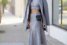 With gray crop top, gray midi skirt, coat and crossbody bag