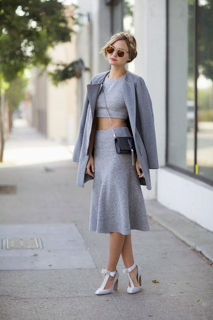 With gray crop top, gray midi skirt, coat and crossbody bag