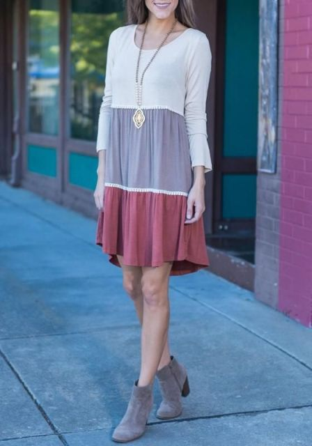 With gray suede ankle boots and necklace