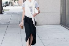 With gray t-shirt, white scarf and black skirt