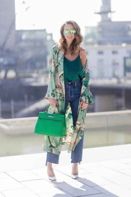 With green top, jeans, green bag and white shoes
