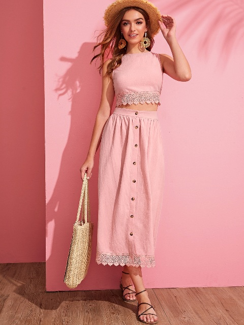 With hat, tote bag, pale pink maxi skirt and lace up sandals