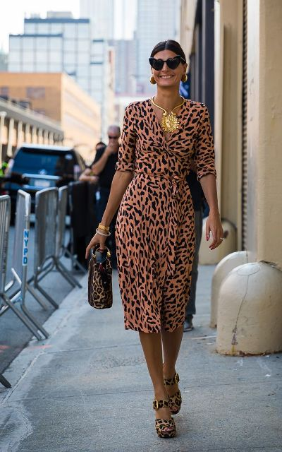 With leopard cutout shoes and leopard bag