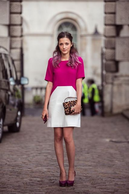 With leopard printed clutch and platform shoes