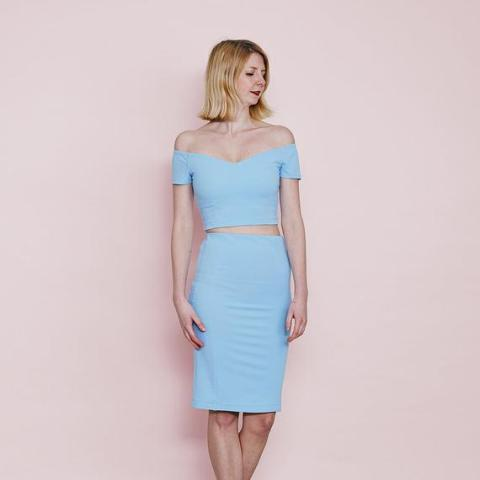 With light blue high-waisted knee-length skirt